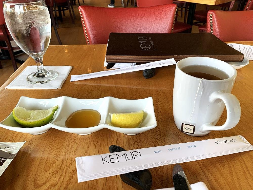 Hot tea at Kemuri involves the customer choosing from a selection of Eastern and Western tea bags; the waiter provides lemon and lime wedges and a small pool of honey.