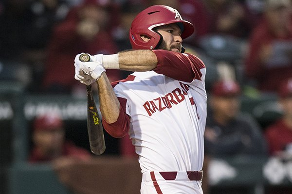 Arkansas second baseman Jack Kenley bats during a game against LSU on Thursday, May 9, 2019, in Fayetteville.