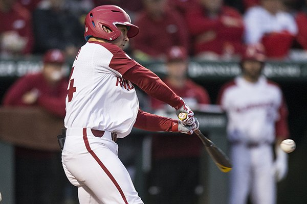 Arkansas center fielder Dominic Fletcher hits a home run during the third inning of a game against LSU on Thursday, May 9, 2019, in Fayetteville.