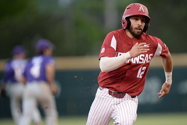 Arkansas catcher Casey Opitz heads to the plate Friday, May 10, 2019, on a double by left fielder Christian Franklin during the third inning against LSU at Baum-Walker Stadium in Fayetteville.