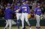 LSU coach Paul Mainieri (left) takes the baseball from pitcher Zack Hess (38) during a game Friday, May 10, 2019, in Fayetteville.