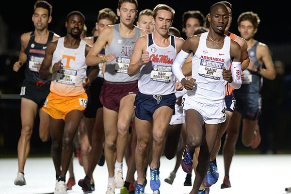 Arkansas' Gilbert Boit (right) leads the field Thursday, May 9, 2019, in the 10,000 meters during the SEC Outdoor Track and Field Championships at John McDonnell Field in Fayetteville.