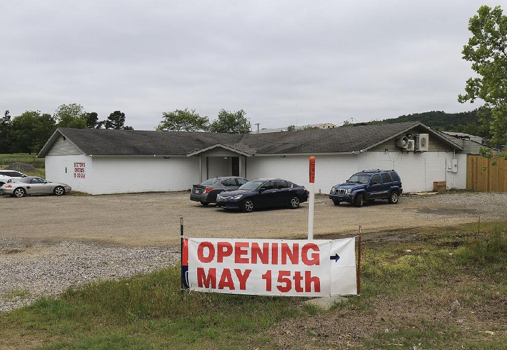 Doctors Orders RX on U.S. 270 east of Hot Springs on Friday became the first medical marijuana dispensary to serve a patient in Arkansas, albeit to test software. Despite what the sign says, the dispensary was to open at 8 a.m. today.
