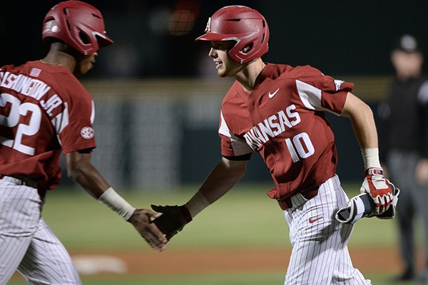 Arkansas designated hitter Matt Goodheart (10) is replaced by pinch runner Curtis Washington after Goodheart hit an RBI single during the eighth inning of a game against LSU on Friday, May 10, 2019, in Fayetteville.
