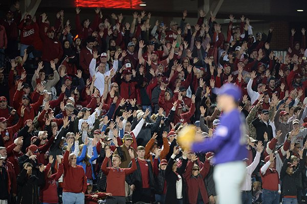 Arkansas fans cheer during a game against LSU on Friday, May 10, 2019, in Fayetteville.