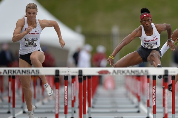 Arkansas' Janeek Brown (center) leads Tonea Marshall of LSU and Payton Chadwick (left) as they compete Saturday, May 11, 2019, in the 100-meter hurdles during the SEC Outdoor Track and Field Championships at John McDonnell Field in Fayetteville. Visit nwadg.com/photos to see more photographs from the meet.