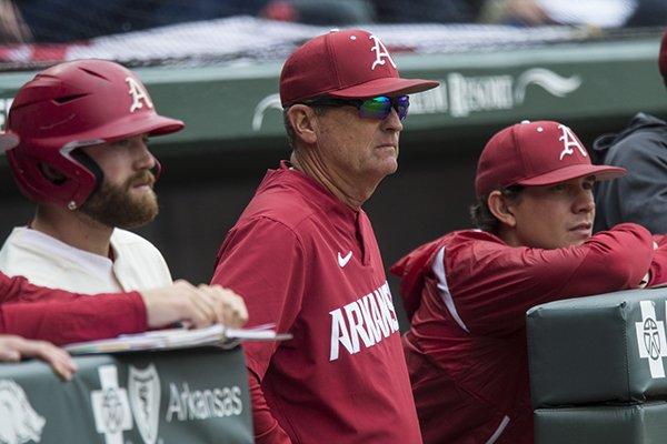 Trevor Ezell (from left), Arkansas first baseman, Dave Van Horn, Arkansas head coach, and Harrison Heffley, student assistant watch from the dugout in the 5th inning vs LSU Saturday, May 11, 2019, at Baum-Walker Stadium in Fayetteville.