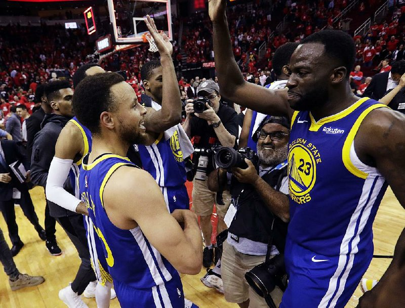 3b98ca764be Golden State Warriors guard Stephen Curry (left) and forward Draymond Green  (right) celebrate after beating the Houston Rockets 118-113 in Game 6 of  the ...
