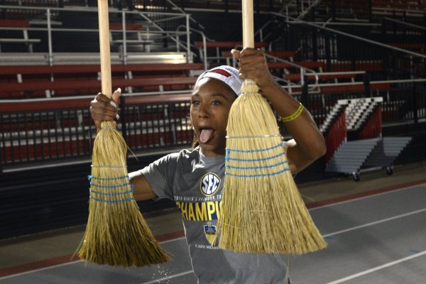 Arkansas' women's track and field athlete Kiara Parker celebrates with brooms Saturday, May 11, 2019, after winning the SEC Outdoor Track and Field Championship at John McDonnell Field in Fayetteville. Visit nwadg.com/photos to see more photographs from the meet.