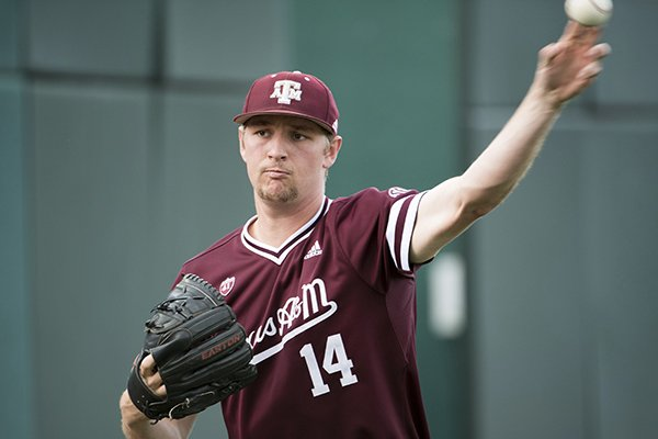 Texas A&M pitcher John Doxakis throws to a teammate before an NCAA college baseball game, Thursday, April 18, 2019, in Columbia, S.C. (AP Photo/Sean Rayford)