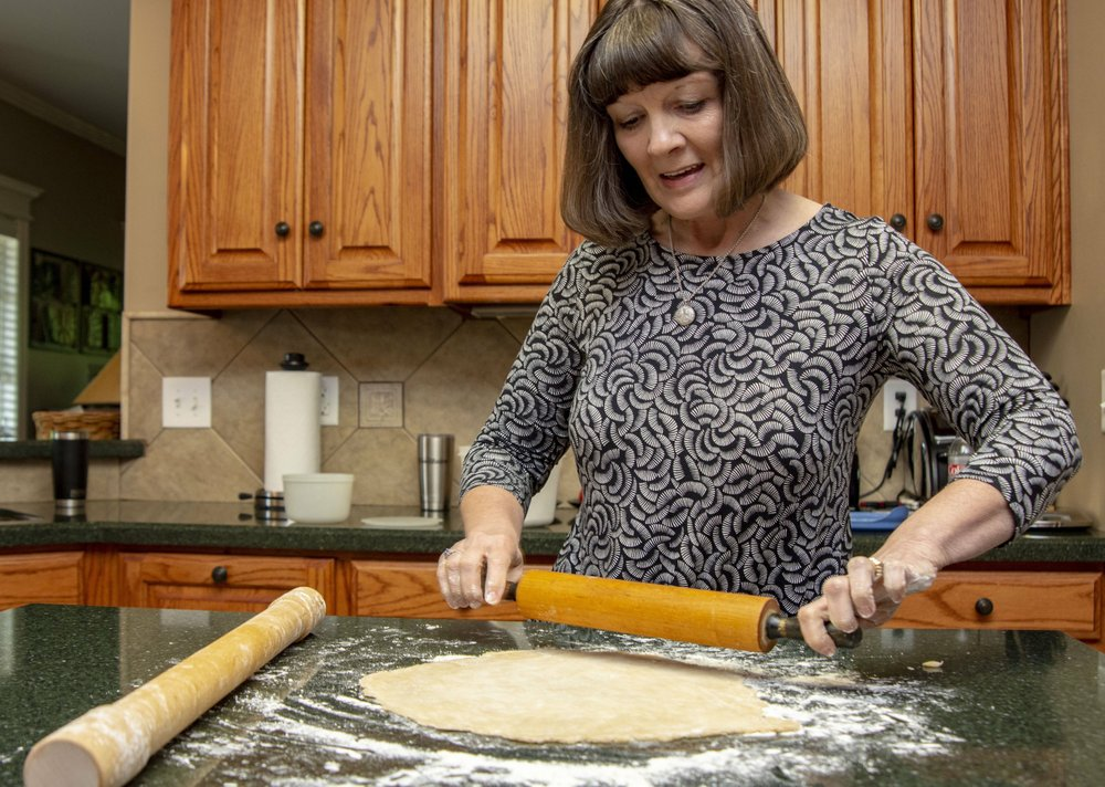 Rhonda Hull rolls a pie crust using her late mother's rolling pin. Photo by Cary Jenkins