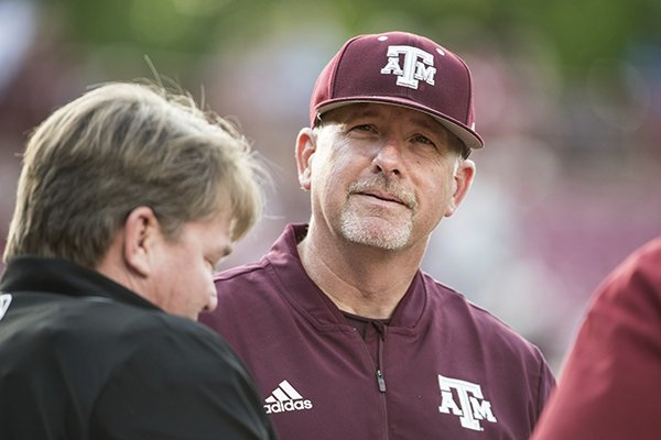 Texas A&M head coach Rob Childress listens during the plate meeting before an NCAA college baseball game, Thursday, April 18, 2019, in Columbia, S.C. (AP Photo/Sean Rayford)