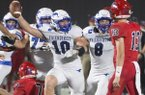 Friendswood linebacker Jake Yurachek (10) holds up a football during a playoff game against Dawson on Friday, Nov. 17, 2017, in Pearland, Texas.
