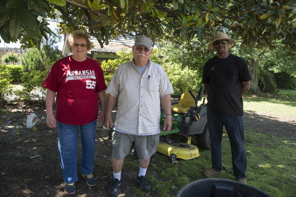 Doris Warren of CCAPS (left), Reid Clark (center) and Charles Davis also volunteered and aided in Wednesday's cleanup.