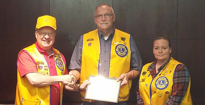 Submitted photo NEW MEMBER: South Hot Springs Lions Club recently installed a new member, Jimmy Sorrels, center, with President Larry Louden, left, and club sponsor Carrie Avaritt.