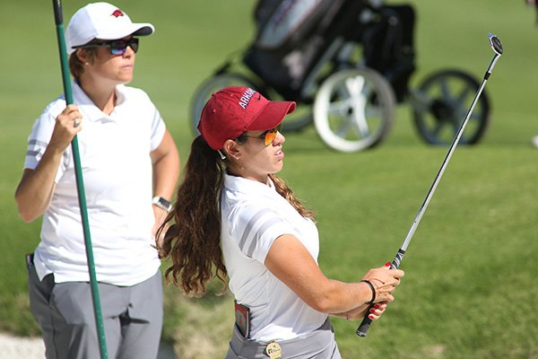 Arkansas golfer Maria Fassi works from the bunker on the seventh hole while head coach Shauna Taylor watches from behind during the practice round of the NCAA Women's Golf Championships at Blessings Golf Club in Johnson on Thursday, May 16, 2019.