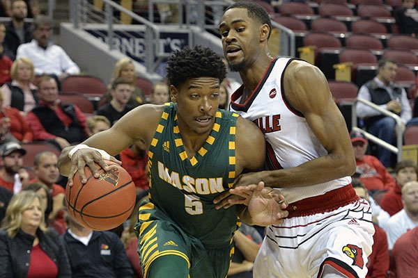 George Mason guard Jaire Grayer (5) attempts to drive past the defense of Louisville forward V.J. King (0) during the first half of an NCAA college basketball game, Sunday, Nov. 12, 2017, in Louisville, Ky. (AP Photo/Timothy D. Easley)