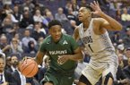 Jacksonville guard JD Notae, left, dribbles against Georgetown forward Jamorko Pickett, right, during the first half of an NCAA college basketball game, Sunday, Nov. 12, 2017, in Washington. (AP Photo/Nick Wass)