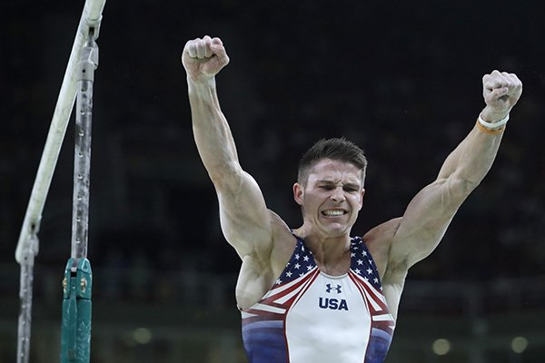 United States' Chris Brooks celebrates after performing on the parallel bars during the artistic gymnastics men's qualification at the 2016 Summer Olympics in Rio de Janeiro, Brazil, Saturday, Aug. 6, 2016. (AP Photo/Julio Cortez)