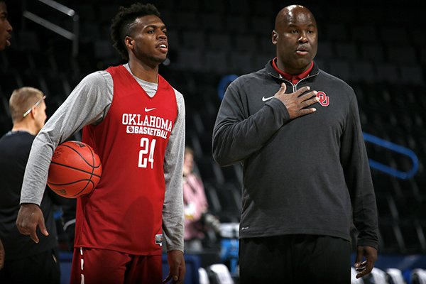 Oklahoma assistant Chris Crutchfield (right) talks with Oklahoma guard Buddy Hield during practice prior to the first round of the NCAA Men's Basketball Tournament at Chesapeake Energy Arena in Oklahoma City on Thursday, March 17, 2016.