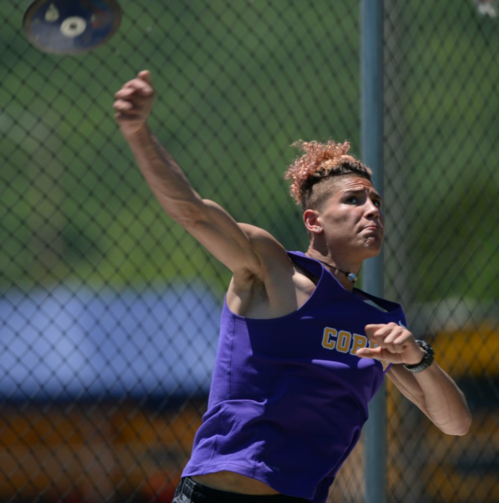 NWA Democrat-Gazette/Andy Shupe LET IT FLY: Fountain Lake senior Ahman Johnson releases the discus during the state decathlon championship at Ramay Junior High School in Fayetteville Thursday. Johnson, despite having competed in just four of the 10 events in high school, finished fifth overall and was the top 4A finisher in the competition.