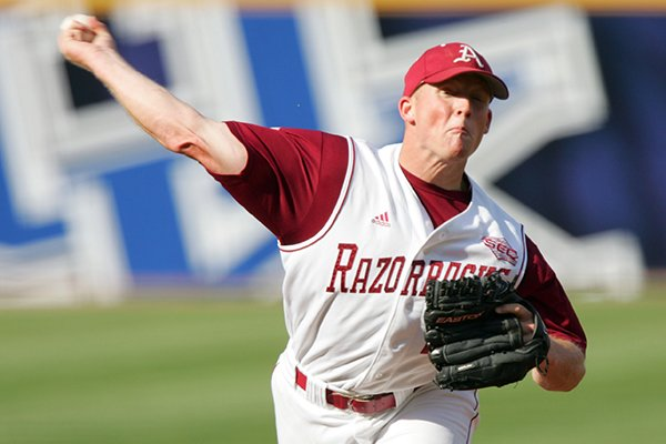 Arkansas' Jess Todd pitches against South Carolina during an SEC baseball tournament game, in Hoover, Ala., Thursday, May 24, 2007. (AP Photo/Neil Brake)