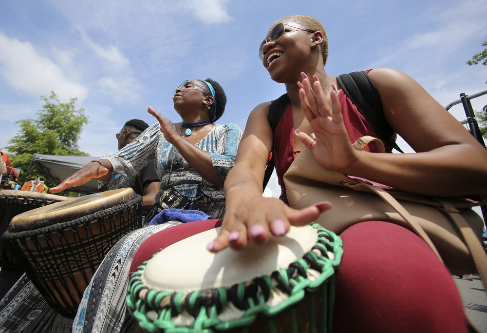 Denisha Cleaves (right) of Memphis and Shakeenah Kadem (left) of Fort Smith play the drums during the 2019 Africa Day Fest. Photo by Thomas Metthe, Democrat-Gazette