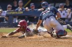 Arkansas pinch runner Curtis Washington slides safely into home plate under the tag of Ole Miss catcher Cooper Johnson during an SEC Tournament game on Wednesday, May 22, 2019, in Hoover, Ala.