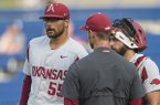 Arkansas pitcher Isaiah Campbell (55), catcher Casey Opitz and pitching coach Matt Hobbs talk during an SEC Tournament game against Georgia on Thursday, May 23, 2019, in Hoover, Ala.