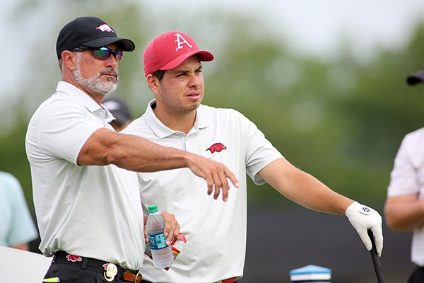 Arkansas golfer Julian Perico (right) talks with Razorbacks head coach Brad McMakin during a practice round for the NCAA Men's Golf Championships at Blessings Golf Club on Thursday, May 23, 2019, in Fayetteville.