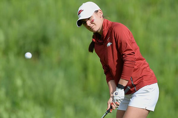 Kaylee Benton of Arkansas chips onto the 13th green Tuesday, May 21, 2019, during her match with Jennifer Kupcho of Wake Forest in the Women's NCAA Golf Championship at Blessings Golf Club in Fayetteville.