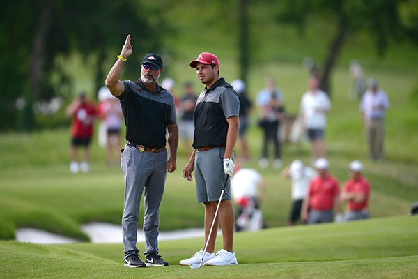 Arkansas men's golf coach Brad McMakin (left) and Julian Perico speak Friday, May 24, 2019, on the fifth fairway during the first day of play in the Men's NCAA Golf Championships at Blessings Golf Club in Fayetteville.