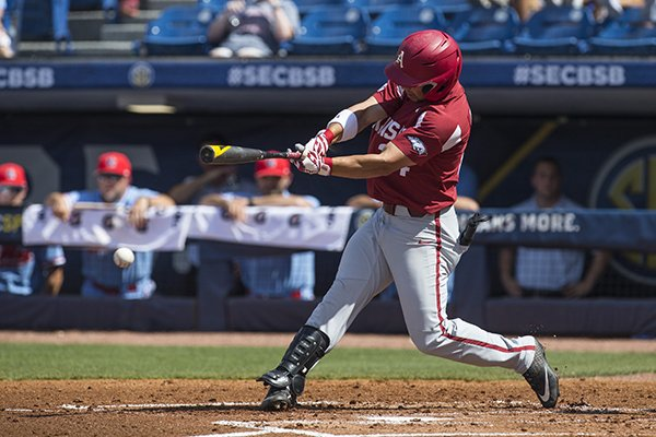 Arkansas center fielder Dominic Fletcher swings at a pitch during an SEC Tournament game against Ole Miss on Friday, May 24, 2019, in Fayetteville.