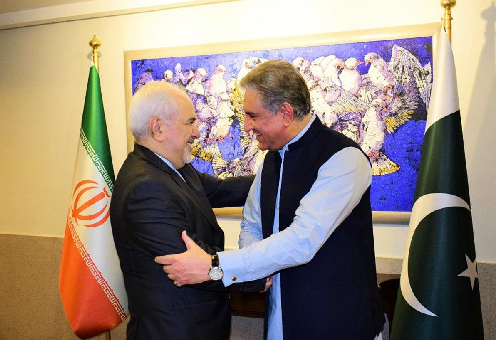 """Iranian Foreign Minister Mohammad Javad Zarif (left) meets with Pakistani Foreign Minister Shah Mehmood Qureshi in Islamabad on Friday. Zarif, responding to a tweet by President Donald Trump, said that """"Iran will see the end of Trump, but he will never see the end of Iran."""""""