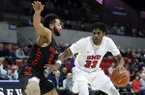 Houston guard Galen Robinson Jr. (25) defends against SMU guard Jimmy Whitt Jr. (33) during an NCAA college basketball game, Wednesday, Jan. 16, 2019, in Dallas. (AP Photo/Tony Gutierrez)