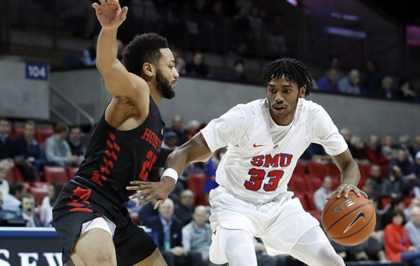 970fc254182 Men's Basketball. Houston guard Galen Robinson Jr. (25) defends against SMU  guard Jimmy Whitt Jr