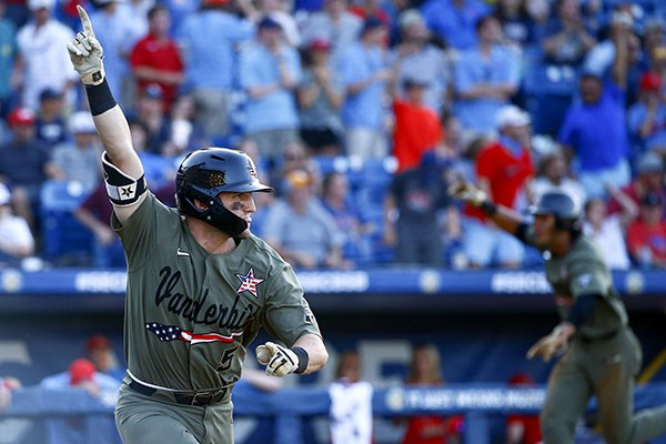 Vanderbilt's Philip Clarke (5) reacts after hitting a walkoff RBI-single to bring in Austin Martin, background, to score and defeat Mississippi during the ninth inning of the Southeastern Conference tournament NCAA college baseball championship game, Sunday, May 26, 2019, in Hoover, Ala. (AP Photo/Butch Dill)