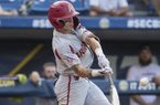 Arkansas shortstop Casey Martin swings the bat during an SEC Tournament game against Georgia on Thursday, May 23, 2019, in Hoover, Ala.