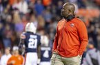 Liberty head coach Turner Gill looks on during an injury break in the second half of an NCAA college football game against Auburn, Saturday, Nov. 17, 2018, in Auburn, Ala. (AP Photo/Vasha Hunt)
