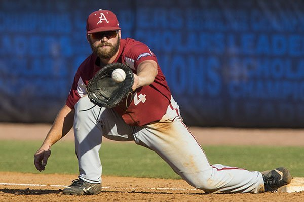 Arkansas first baseman Trevor Ezell fields a ball during an SEC Tournament game against Ole Miss on Friday, May 24, 2019, in Hoover, Ala.