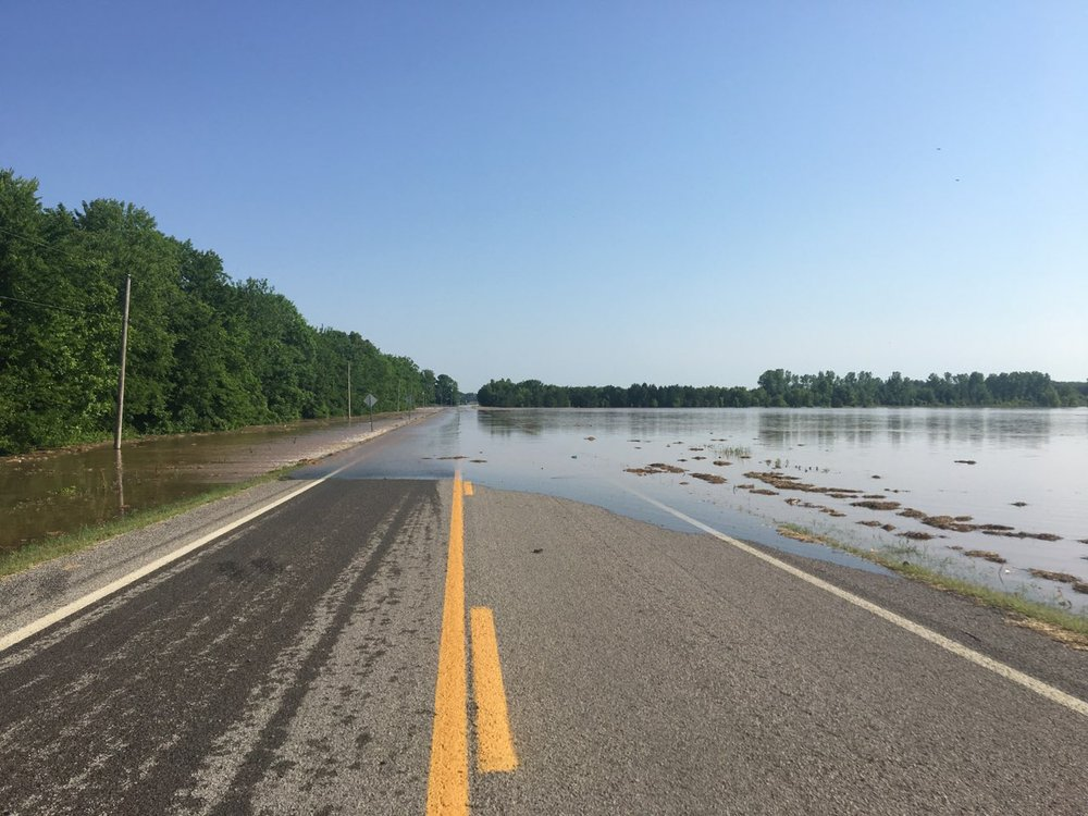 Arkansas 155 is covered by water near Holla Bend after a levee broke nearby early Friday.