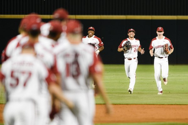 Arkansas Razorbacks players react after a 6-0 victory against Texas Christian University during the NCAA Division I Baseball Championship Regionals, Sunday, June 2, 2019 at Baum-Walker Stadium in Fayetteville.