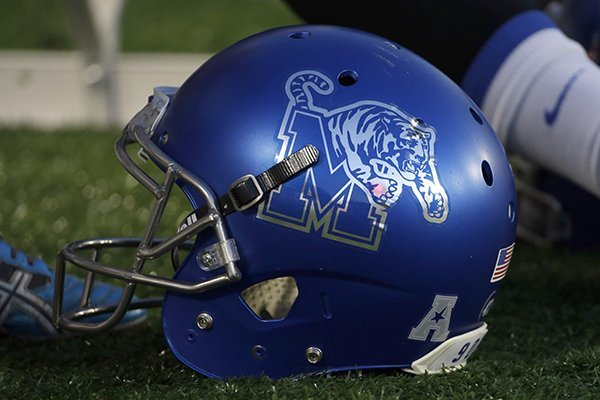 A Memphis helmet sits on the ground before an NCAA college football game against Houston Saturday, Nov. 14, 2015, in Houston. (AP Photo/David J. Phillip)
