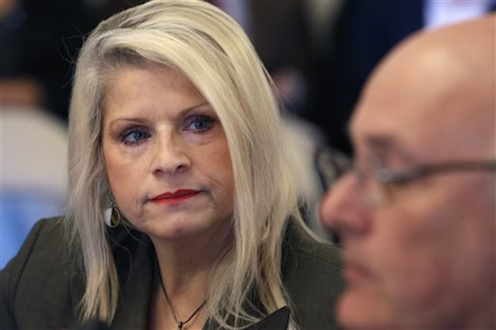 Sen. Linda Collins-Smith, R-Pocahontas, listens to testimony at a meeting of the Senate Committee on Public Health, Welfare, and Labor at the state Capitol in Little Rock on Wednesday, Jan. 28, 2015. -ADG File photo