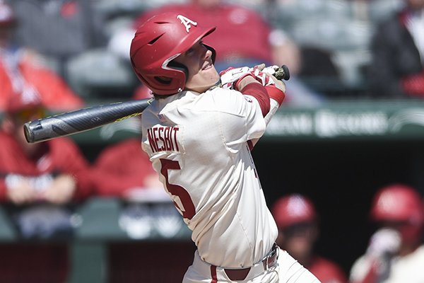 Arkansas third baseman Jacob Nesbit bats during a game against Ole Miss on Sunday, March 31, 2019, in Fayetteville.