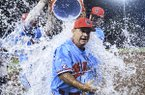 Ole Miss head coach Mike Bianco gets a water bath following a win over Jacksonville State in an NCAA college baseball regional game, in Oxford, Miss., Sunday, June 2, 2019. (Bruce Newman/The Oxford Eagle via AP)