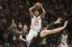 Virginia Tech forward Kerry Blackshear Jr. (24) sets to pass to a teammate against Miami during the second half of an NCAA college basketball game in Blacksburg, Va., Friday, March 8, 2019. (AP Photo/Lee Luther Jr.)