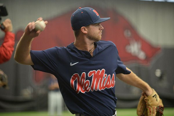 Ole Miss shortstop Jacob Adams throws during practice Friday, June 7, 2019, in Fayetteville. Adams, of Conway, and Ole Miss will meet Arkansas in the first game of the NCAA Fayetteville Super Regional on Saturday.