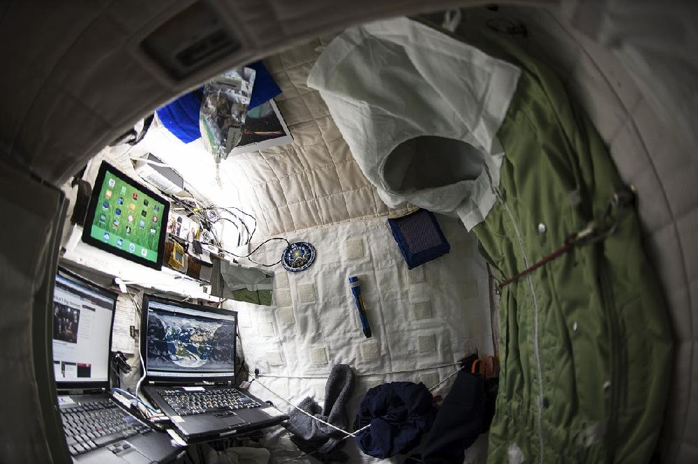 "This photo from NASA shows American astronaut Scott Kelly's living quarters aboard the space station in 2015. Private astronauts soon will get to live in such quarters. ""But it won't come with any Hilton or Marriott points,"" Jeff DeWit, NASA's chief financial officer, said Friday."