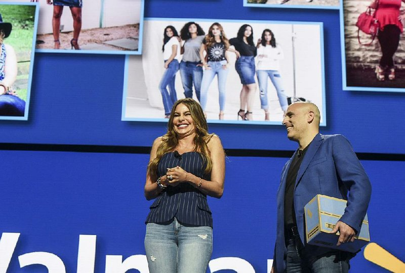 129ee68d1f Sofia Vergara of the Modern Family television series and Marc Lore, chief  executive of Walmart e-commerce in the United States, show off the line of  jeans ...